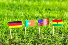 Corte do papel das bandeiras para o campeonato 2014 do futebol, grupo G Foto de Stock