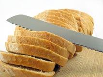 Corte e faca do pão Fotos de Stock