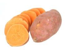 Corte e inteiro de batatas doces Imagens de Stock Royalty Free