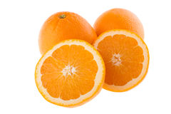 Corte e laranjas inteiras Fotografia de Stock