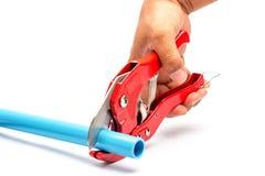 Corte e mão da tubulação do PVC Fotos de Stock
