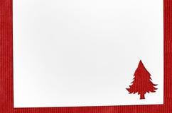 Corte el papel en forma del abeto en la tabla Foto de archivo libre de regalías