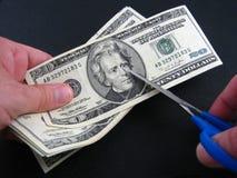 Corte em o orçamento e impostos Fotografia de Stock Royalty Free