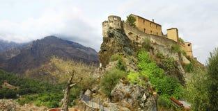 Corte - Korsika, sikt med citadellen arkivfoto