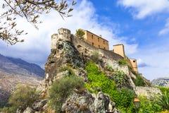 Corte - Korsika, sikt med citadellen arkivbild