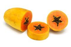 Corte la fruta de la papaya fotos de archivo