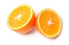 Corte la naranja en el fondo blanco fotografía de archivo