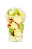 Corte las frutas en taza plástica fotos de archivo libres de regalías