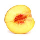 Corte maduro da fruta do pêssego isolado fotografia de stock