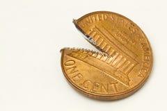 Corte a moeda de um centavo Fotografia de Stock Royalty Free