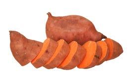 Corte na fatia e inteiro de batatas doces Fotos de Stock Royalty Free