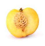 Corte natural da fruta do pêssego isolado no branco fotos de stock