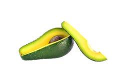 Corte o abacate em um fundo branco Foto de Stock
