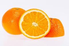 Corte o fruto da laranja isolado no fundo branco Fotos de Stock Royalty Free