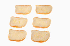 Corte partes do pão branco no fundo branco Imagem de Stock Royalty Free