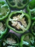 Corte a paz de pimentas verdes fotografia de stock