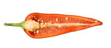 Corte a pimenta vermelha em um fundo branco Fotografia de Stock