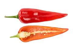 Corte pimentas vermelhas em um fundo branco Foto de Stock