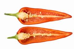 Corte pimentas vermelhas em um fundo branco Imagens de Stock Royalty Free