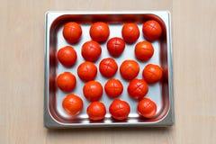 Corte rojo de los tomates Imágenes de archivo libres de regalías