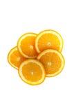 Corte suculento da laranja em partes e posto sobre uma superfície branca Fotografia de Stock Royalty Free
