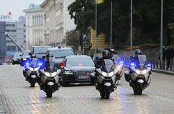 Cortege cars motorcycles police. Sofia, Bulgaria - October 15, 2015: Cortege of a Chinese delegation in Sofia. The cars of the diplomats are surrounded by Royalty Free Stock Image