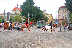 Cortege with riders on horseback on the streets in historical city center, Lviv. Ukraine Stock Photos