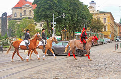 Cortege with riders on horseback on the streets. In historical city center, Lviv, Ukraine Stock Images