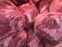 Cortes de carne de porco crus nos pacotes Imagem da foto imagens de stock royalty free