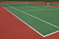Cortes de tênis Fotografia de Stock Royalty Free