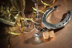 Cortiça da garrafa do champanhe com uma ferradura Fotografia de Stock Royalty Free
