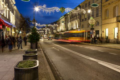 Cortiço apalaçada iluminado na rua de Nowy Swiat Fotografia de Stock Royalty Free