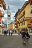 Tourists walking through the main street in Cortina d`Ampezzo stock images