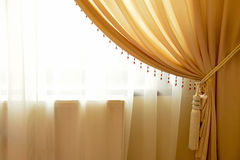 Cortina de ventana beige Foto de archivo libre de regalías
