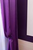Cortina de ventana violeta Fotos de archivo libres de regalías