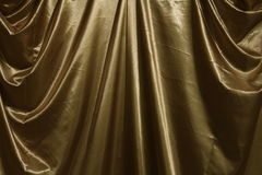 Cortina dourada em interno com luzes Imagem de Stock Royalty Free