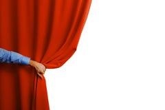Cortina vermelha aberta da mão fotografia de stock royalty free