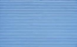 Cortinas horizontais azuis do obturador do rolo foto de stock