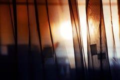 Cortinas na janela Fotografia de Stock Royalty Free