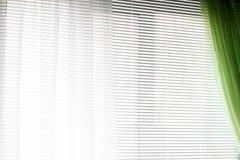 Cortinas nas janelas Fundo das cortinas listras fotografia de stock royalty free