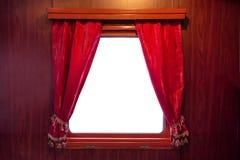Cortinas vermelhas na janela Imagem de Stock