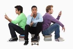 Goup de hombres jovenes aburridos Foto de archivo libre de regalías