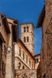 Cortona medieval town with bell tower in Tuscany Stock Images