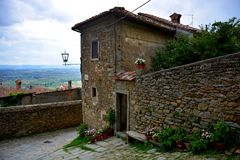 Cortona. Tuscany Italy square  sky windows cloud tower colors country road street courts green Stock Photography