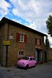 Cortona. Tuscany Italy square  sky windows cloud tower colors country road street courts green door car Stock Photography