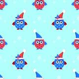 corujas bonitos no teste padrão sem emenda dos chapéus do Natal Imagens de Stock Royalty Free