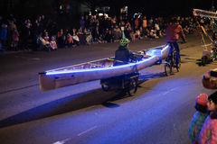 Corvallis Bicycle Collective pulls canoer on trailer in holiday Stock Photo