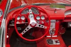 Corvette Dashboard. A photo of the dashboard and steering wheel of a 1962 Corvette Royalty Free Stock Images