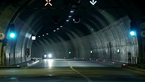 Corvette driving through the tunnel towards the camera