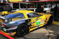 Corvette race car. Pro driver Oliver Gavin has his car worked on in the garage area Stock Images